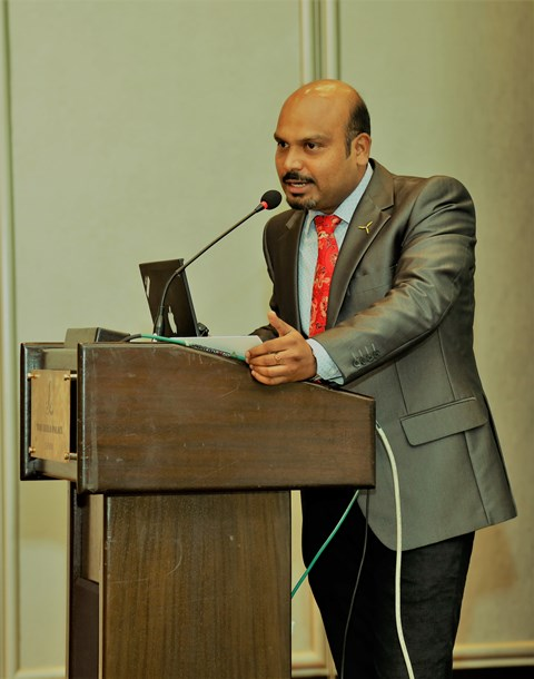 Dr. Kumaravel Rathinavel presenting at a conference