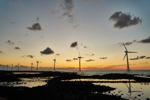 Picture of offshore wind farm off Jeju Island Kore at sunset